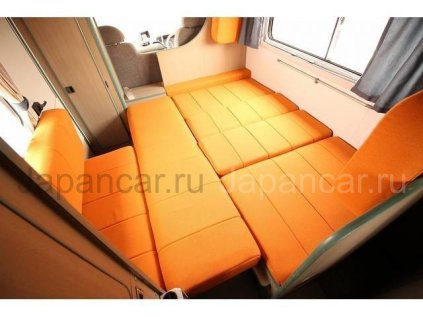 Автобус Isuzu ELF 2000 года во Владивостоке